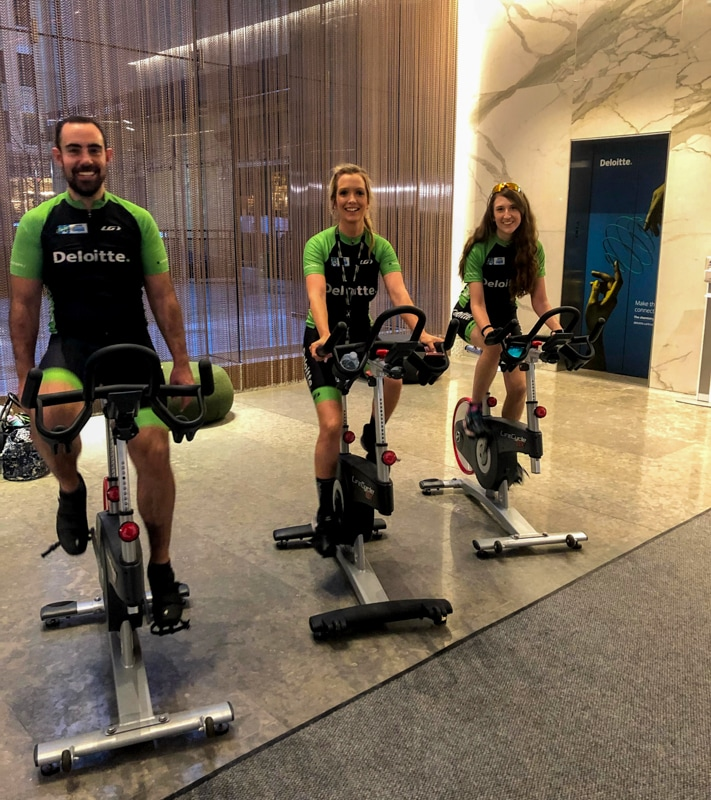 colleagues cycling indoors